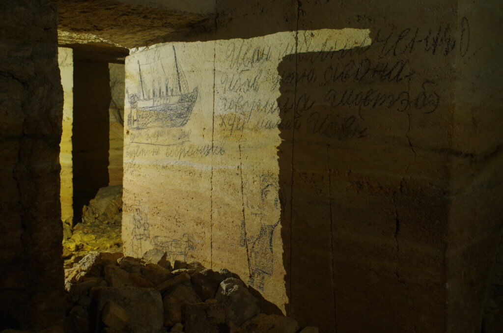 Writtings and drawings of miners in the Odessa catacombs